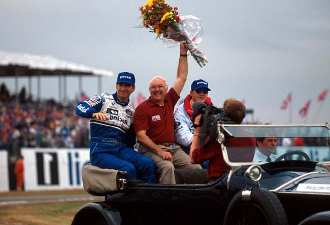 Murray with Damon Hill on a drivers Parade in 1996